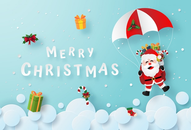 Santa claus make a parachute jump on the sky Premium Vector