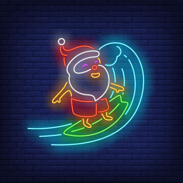 Santa claus on surfboard neon sign Free Vector