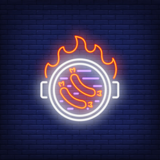 Sausages on barbeque grill with fire flame neon sign Free Vector