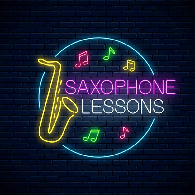 Saxophone lessons glowing neon poster or banner template. music instrument training advertising flyer with circle frame in neon style on dark brick wall Premium Vector