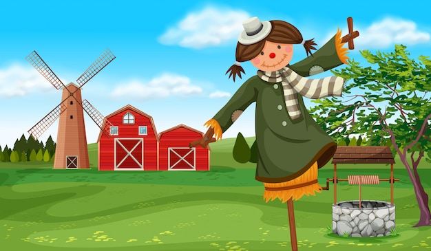 Scarecrow in the farm field Free Vector