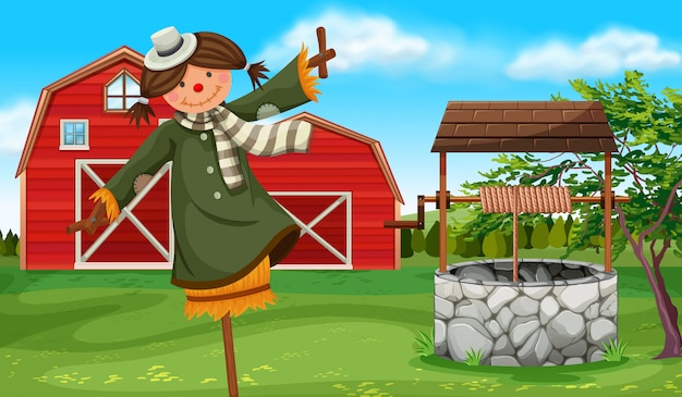 Scarecrow in the farmyard Free Vector