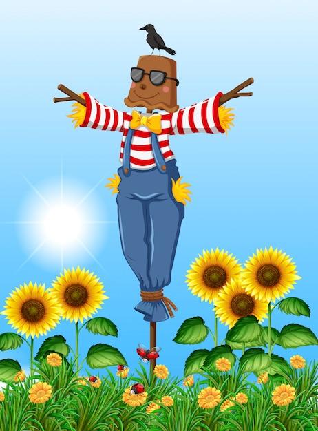 Scarecrow standing in sunflower field Free Vector