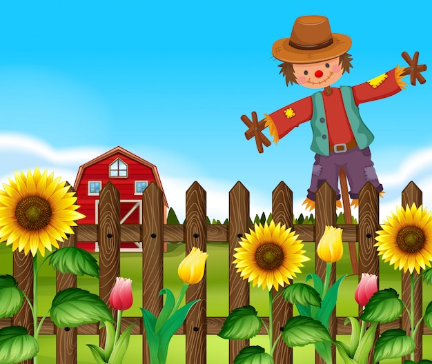 Scarecrow in the sunflower field Free Vector