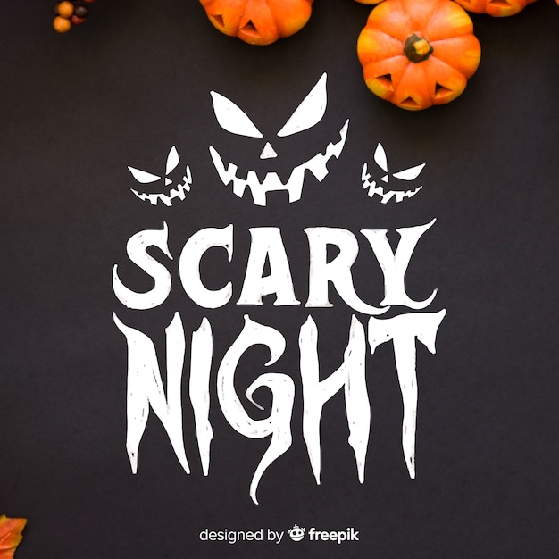 Scary night lettering with pumpkins Free Vector