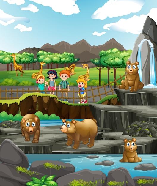 動物園で動物と幸せな子供たちとのシーン Premiumベクター