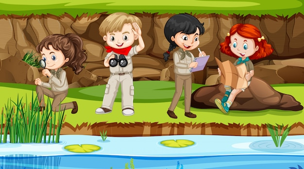 Scene with boys and girls exploring nature by the river Premium Vector