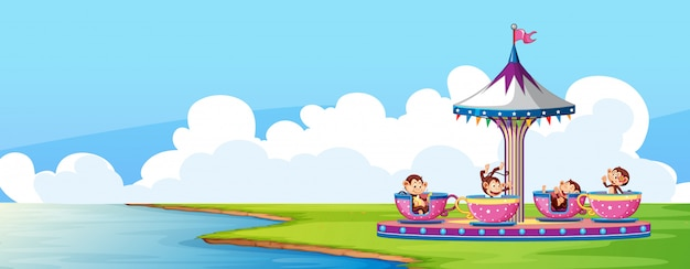 Scene with circus ride in the park and monkeys in the cups Free Vector