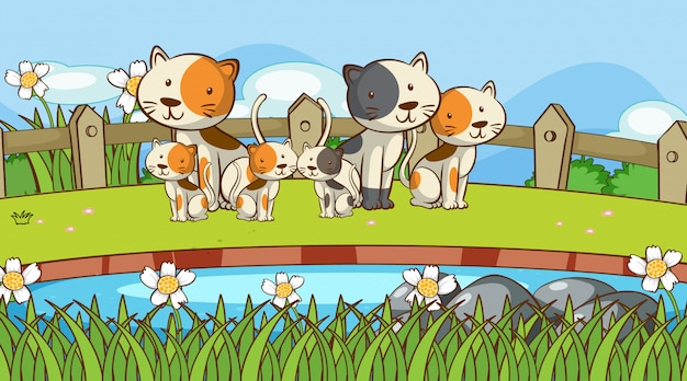 Scene with many cats in the garden Free Vector