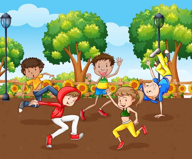 Scene with many children dancing in the park Free Vector