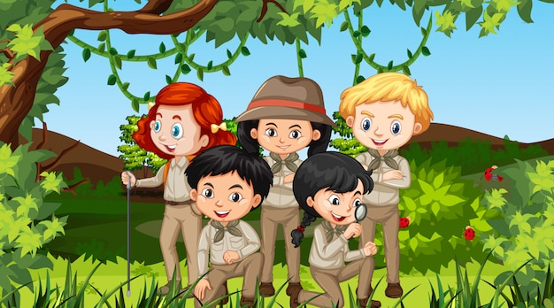 Scene with many children in the park Free Vector