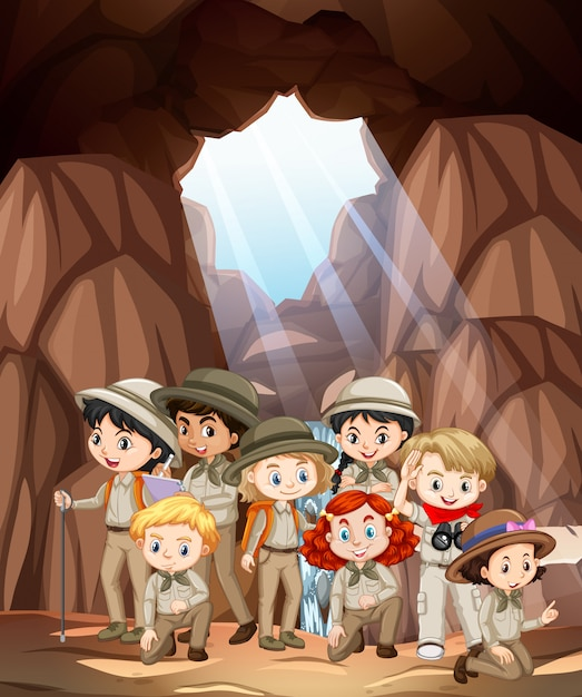 Scene with many kids in the cave Free Vector