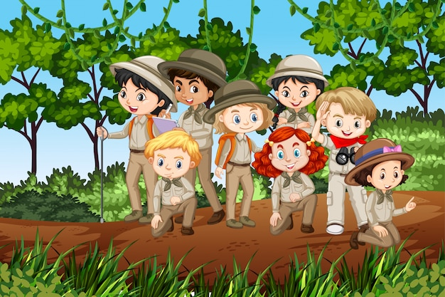 Scene with many kids in scout uniform hiking Premium Vector