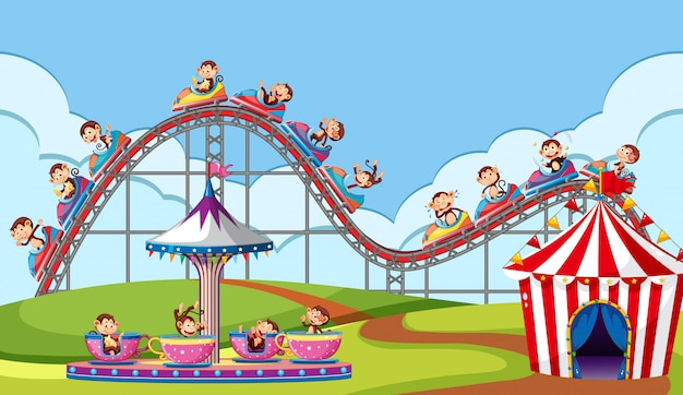 Scene with monkeys riding on circus rides in the park Free Vector