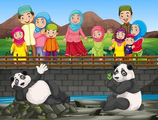 動物園でパンダを見ている人のシーン 無料ベクター