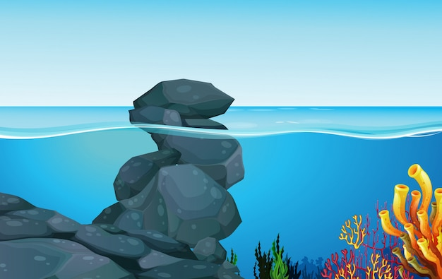 Scene with rocks under the ocean Free Vector