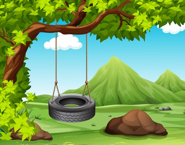 Scene with swing on the tree Free Vector