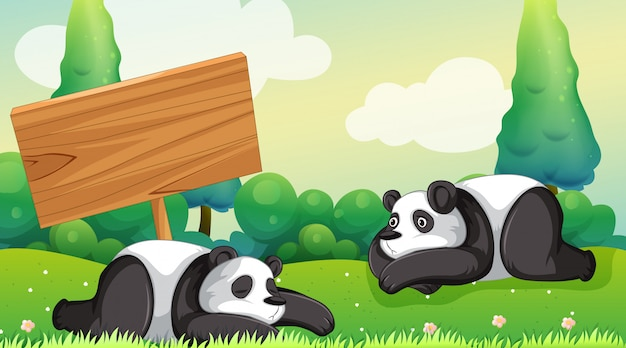 Scene with two pandas in the park Free Vector