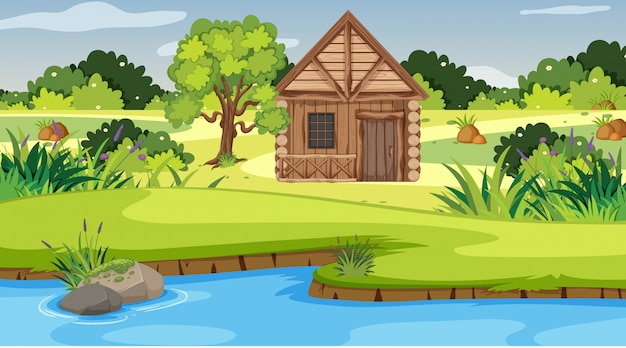 Scene with wooden cottage in the field Premium Vector