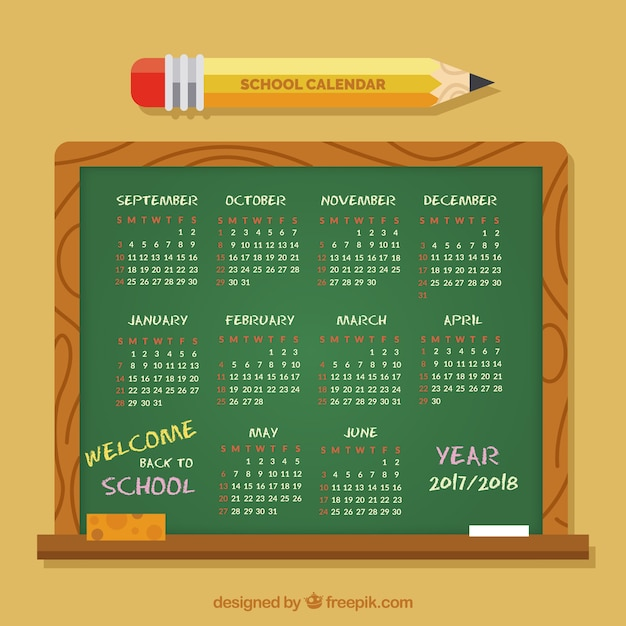 School calendar on blackboard with pencil