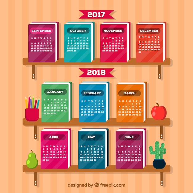 School calendar on colorful books