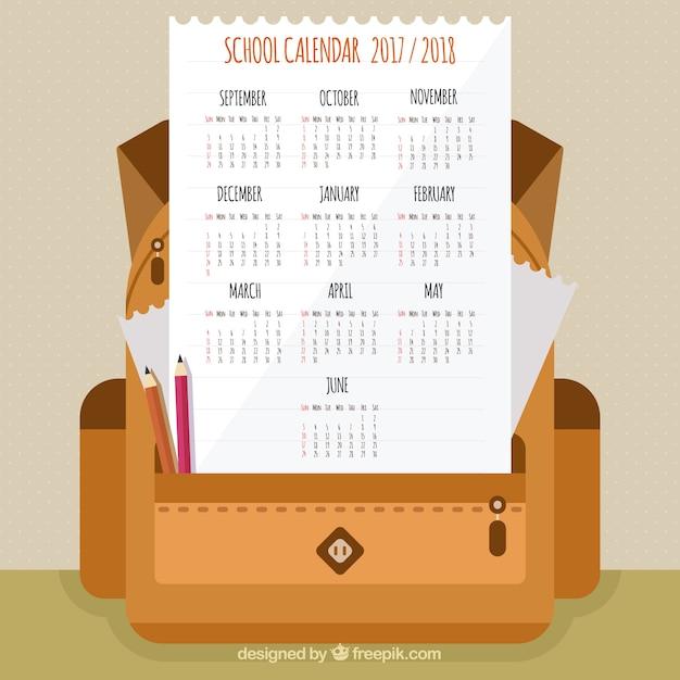 School calendar with flat open backpack
