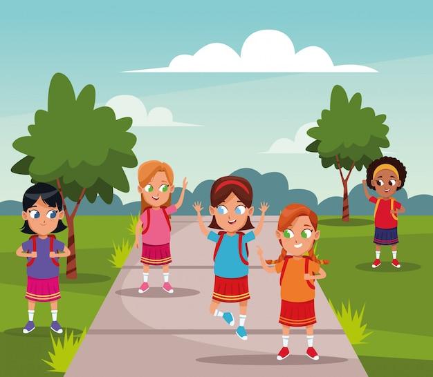 School girls with backpacks cartoons Free Vector