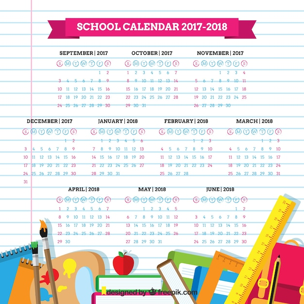 School materials and calendar on notebook paper