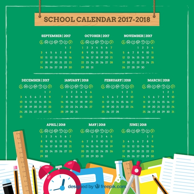 School materials and calendar on the blackboard