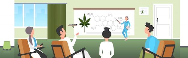 Scientist presenting cbd thc cannabis hemp drug molecule for doctors team at conference meeting medical marijuana formula presentation concept horizontal Premium Vector