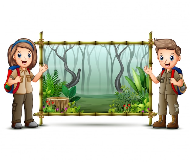 Scout boy and girl near the green bamboo frame Premium Vector
