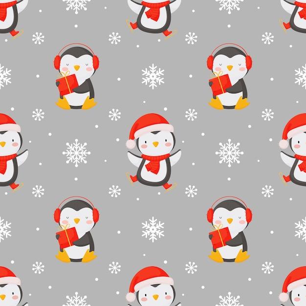 귀여운 펭귄과 눈송이와 완벽 한 크리스마스 배경입니다. 프리미엄 벡터