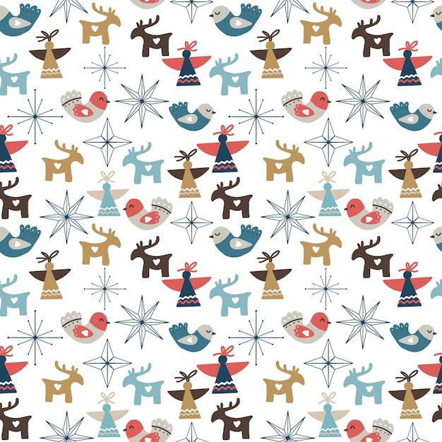 装飾品、星、雪片、天使、鹿とのシームレスなクリスマスパターン Premiumベクター