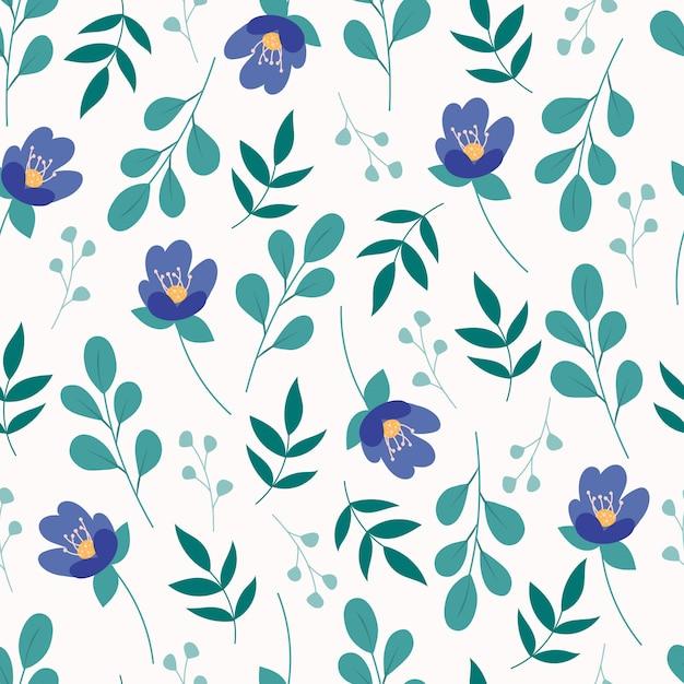 緑の葉と青い花とのシームレスな花柄 Premiumベクター