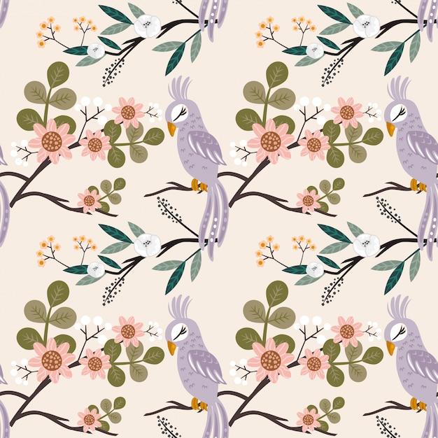 Безшовная картина beautyful птица с много цветка Premium векторы