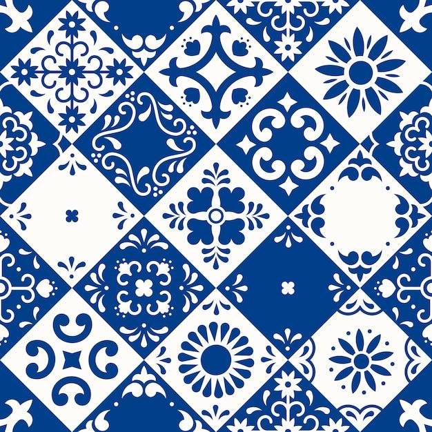 シームレスなパターン。プエブラの伝統的なマジョリカスタイルの花、葉、鳥の装飾が施されたセラミックタイル。クラシックなブルーとホワイトのメキシコの花柄モザイク。民芸デザイン。 Premiumベクター