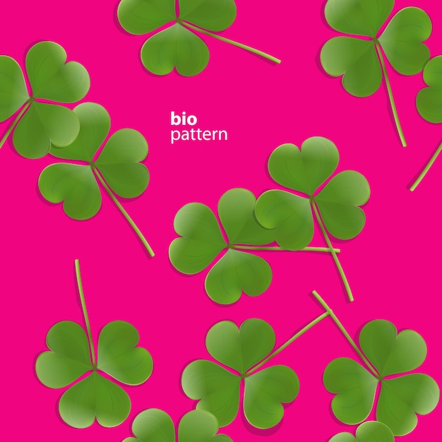 Seamless pattern, green clover leaf on pink background Free Vector