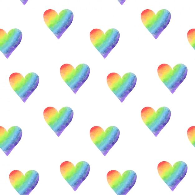 Seamless pattern of simple rainbow watercolor hearts Premium Vector