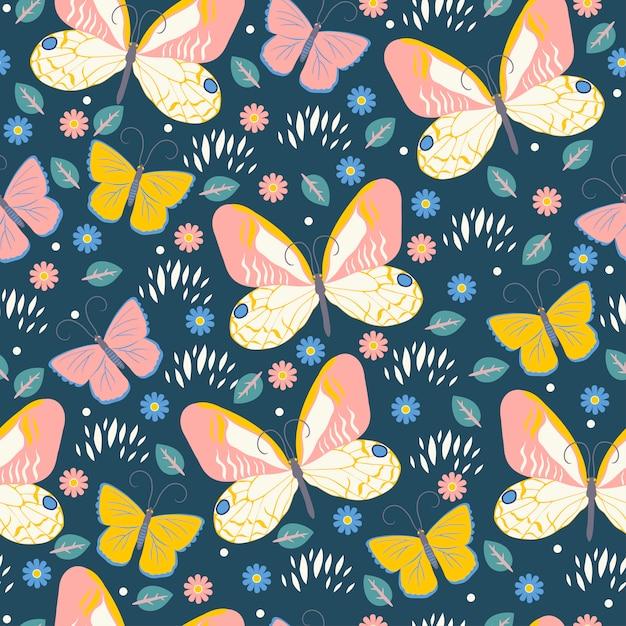 蝶と花とのシームレスなパターン。グラフィック。 Premiumベクター