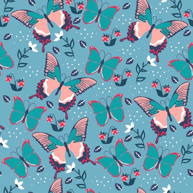 蝶と花とのシームレスなパターン。 Premiumベクター