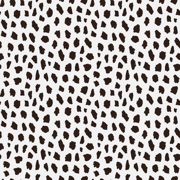 Seamless pattern with cheetah skin. Premium Vector