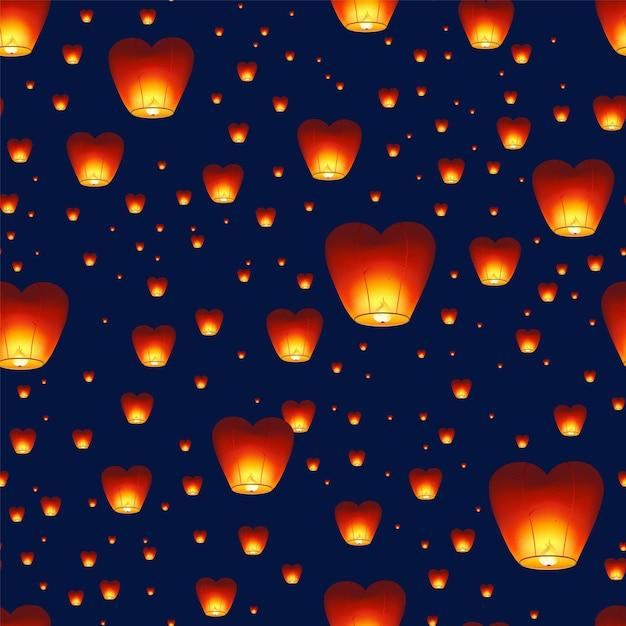 Бесшовный фон с китайскими фонариками, летающими в ночном небе Premium векторы