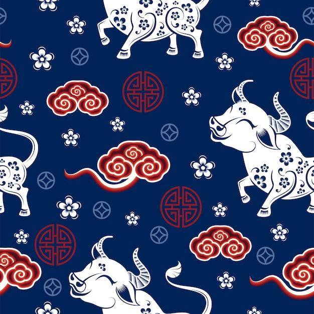 アジアの要素を持つ牛のサインの中国の旧正月干支とのシームレスなパターン 無料ベクター
