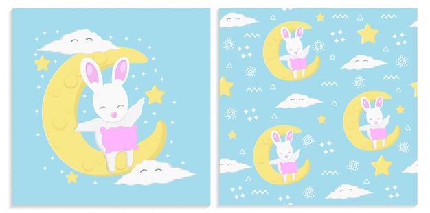 月とかわいいウサギとのシームレスなパターン Premiumベクター