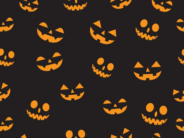 Seamless pattern with faces pumpkin devil Premium Vector