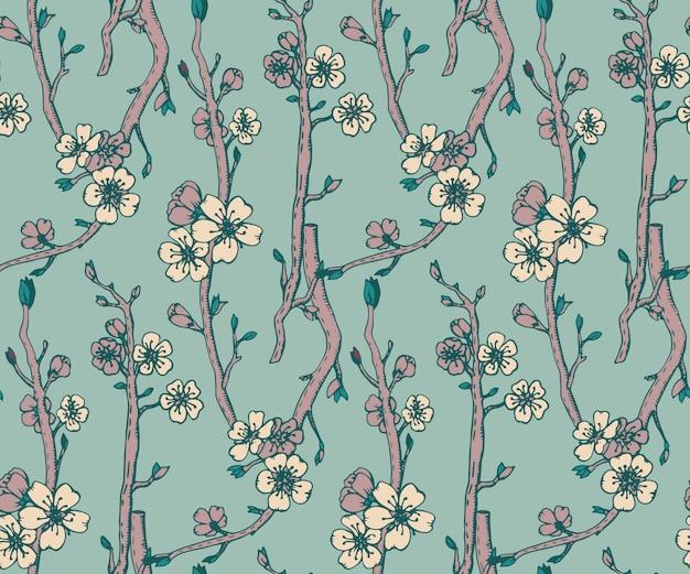 손으로 완벽 한 패턴 꽃이 만발한 가지를 그려 프리미엄 벡터