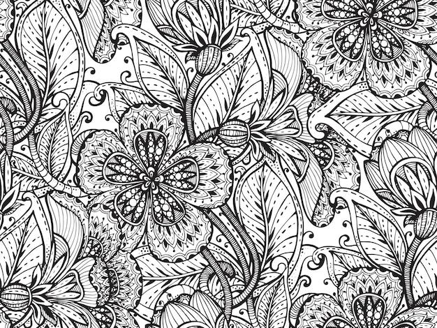 手でシームレスなパターンは、白い背景の上の派手な花を描いた。 Premiumベクター