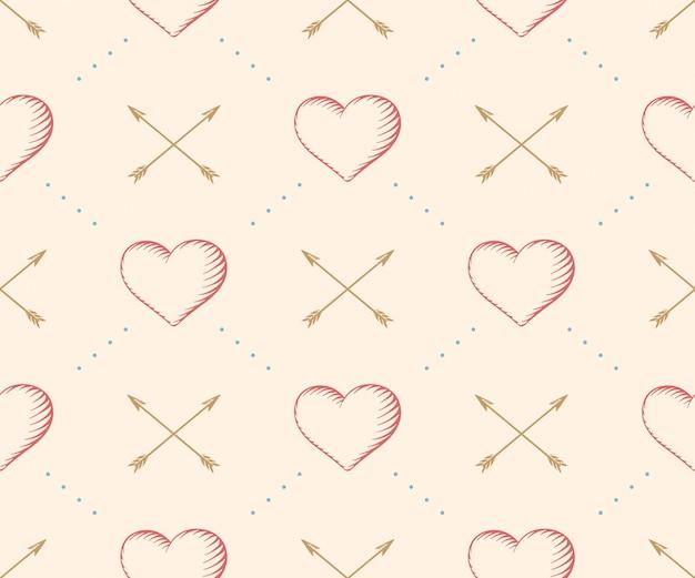 Безшовная картина с сердцем и стрелка в винтажной гравировке стиля на бежевой предпосылке на день валентинки. нарисованный от руки. иллюстрация. Premium векторы