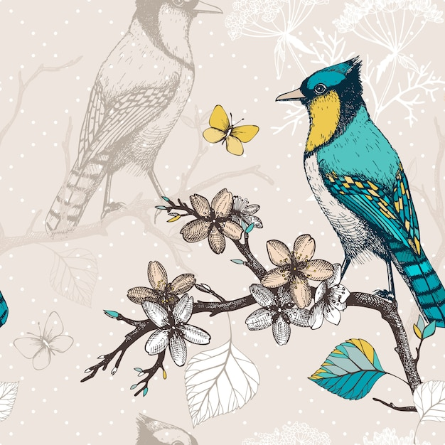 Seamless  pattern with ink hand drawn birds on blooming  tree twigs. vintage sketch background with green birds Premium Vector