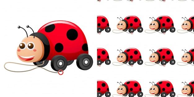 てんとう虫のおもちゃの車とのシームレスなパターン Premiumベクター